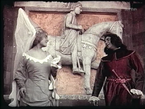Romeo and Juliet meet for the first time. Equestrian statue in the back.